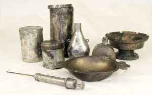 A pewter bleeding bowl and syringe found in the surgeon's cabin. The syringe would have been used with non-corrosive fluids such as rosewater or wine and vinegar, used to flush out wounds.