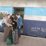 Woman with case boarding a train