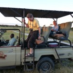 People climbing out of a safari jeep