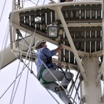 Man climbing the mast of a tall ship